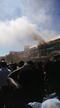 Residents watch as Masvingo POSB Burns